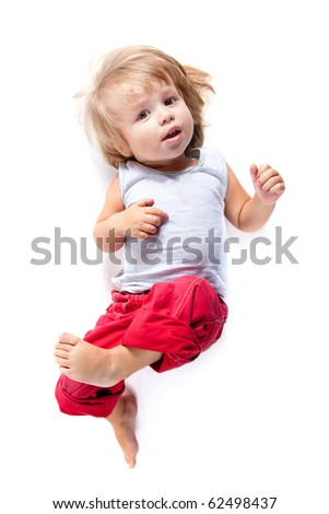 Funny boy in red pants, high angle view, isolated on white background - stock photo