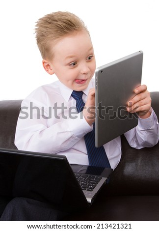 Funny boy in suit playing on  the computer - stock photo
