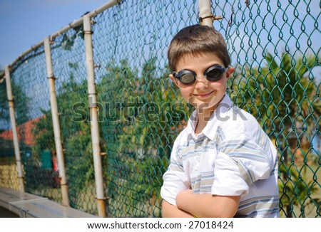 Funny boy in swimming goggles - stock photo
