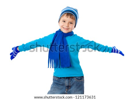 Funny boy in winter clothes with wide spread hands, isolated on white - stock photo