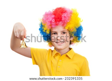 funny boy wears colorful wig and calls by hand bell - stock photo