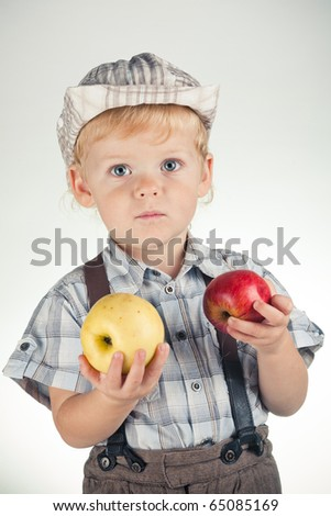 funny boy with apples - stock photo