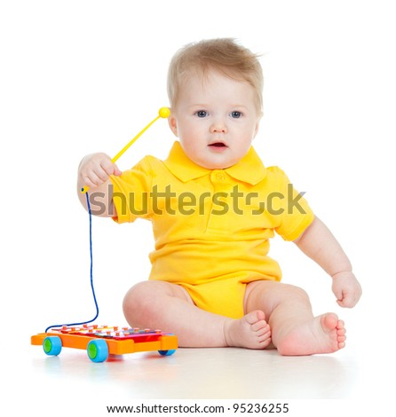 funny boy with musical toys - stock photo