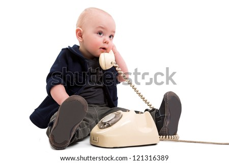 funny boy with old phone - stock photo