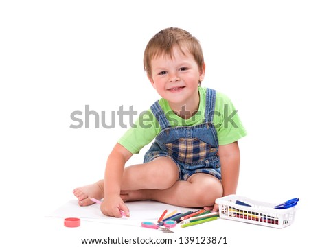 Funny boy with pencil sitting on the floor on white background isolated