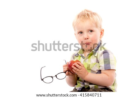 Funny boy with red apple and glasses, close up portrait, isolated on white