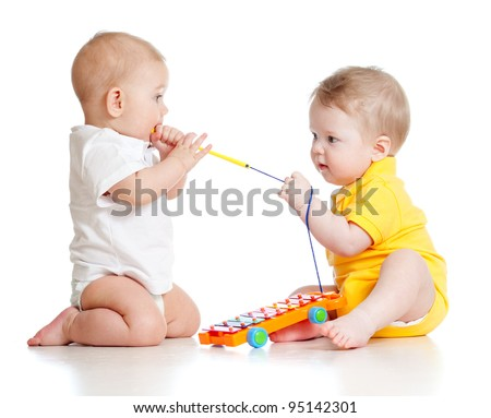 funny boys with musical toys - stock photo