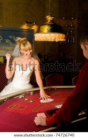 funny bride playing cards in a casino