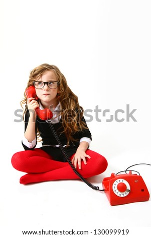 Funny  business little girl with a phone on a white background sitting - stock photo