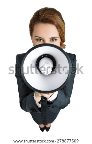 Funny business woman shouting with a megaphone over white background. Focus on eyes