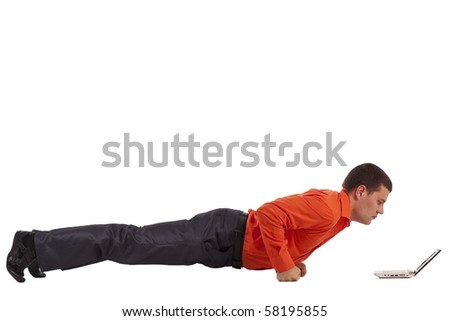 Funny businessman doing push-ups, looking on laptop screen - stock photo