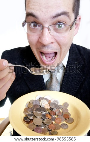 Funny businessman eating money - stock photo