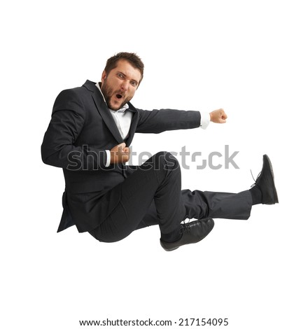funny businessman in black suit kicking as karate. isolated on white background - stock photo