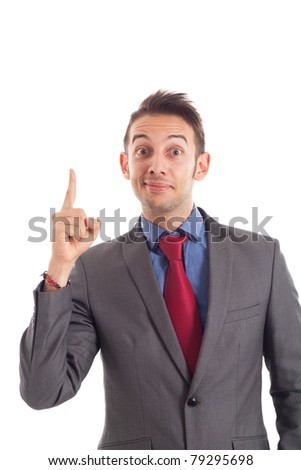 Funny businessman pointing his finger up while looking at you - stock photo
