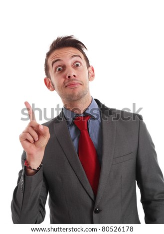 Funny businessman pointing his finger up while looking at you. - stock photo