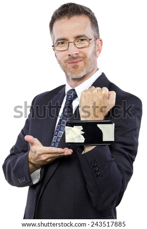 funny businessman tapes a cellphone as a DIY smartwatch - stock photo