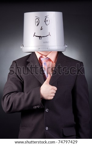 funny businessman with a bucket on his head - stock photo