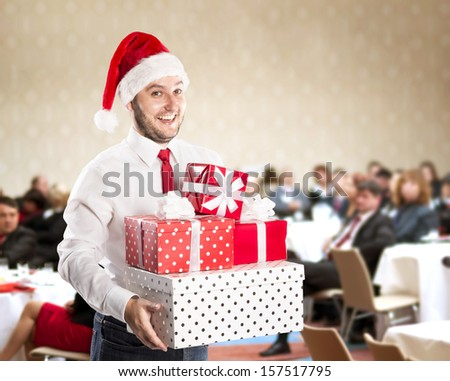 Funny businessman with christmas cap is on conference - stock photo