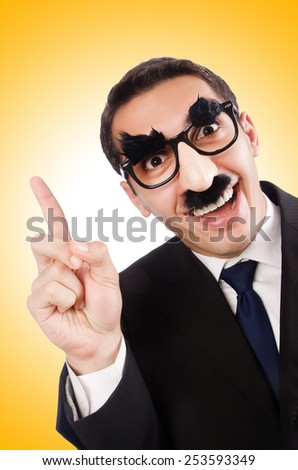 Funny businessman with eyebrows and moustache - stock photo