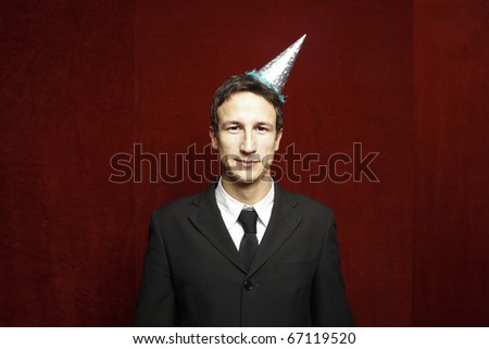 funny businessman with party hat - stock photo