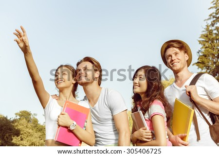 Funny carefree students walk in the park