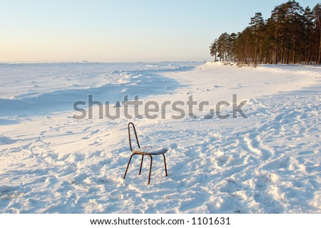 funny chair on coast of frozen sea; Finnish Bay of Baltic Sea, Russia