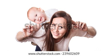 Funny cheerful child and beautiful mother. Happy family. - stock photo