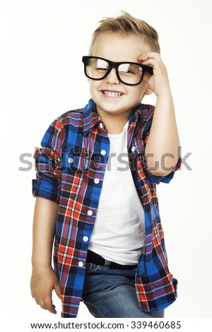 Funny child.fashionable little boy in glasses, jeans, white t-shirt and plaid shirt.stylish kid  in shock and surprise. fashion children