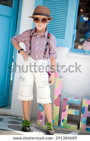 Funny child. Fashionable little boy in sunglasses and hat. Fashion children - stock photo