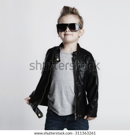 Funny child.fashionable little boy in sunglasses.stylish kid in leather. fashion children - stock photo