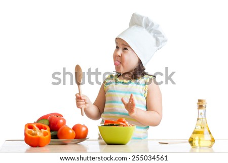 funny child girl preparing healthy food isolated - stock photo