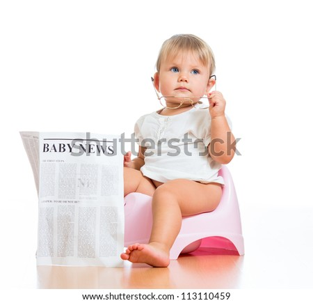 funny child girl sitting on chamberpot with eyeglasses and newspaper - stock photo