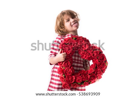 funny child girl with tongue in red checkered dress  with a heart of red flowers, and the concept of Valentine's Day celebration, white background