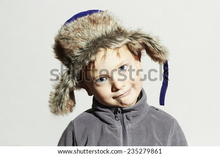 funny child in fur Hat.fashion casual winter style.little boy.children emotion.hat ear flaps - stock photo