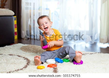funny child playing with colour pyramid