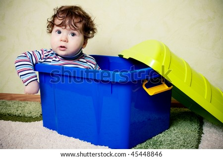 funny child sitting in box - stock photo