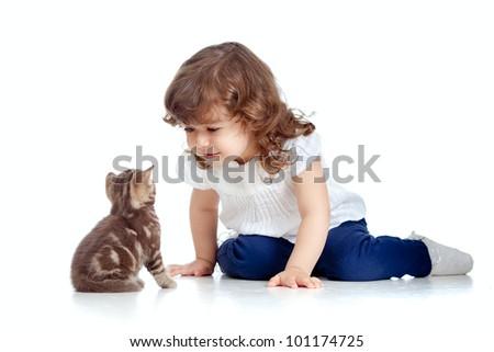 Funny child sitting on floor. Scottish kitten looking at girl. - stock photo