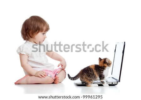 Funny child using a laptop over white background with kitten - stock photo