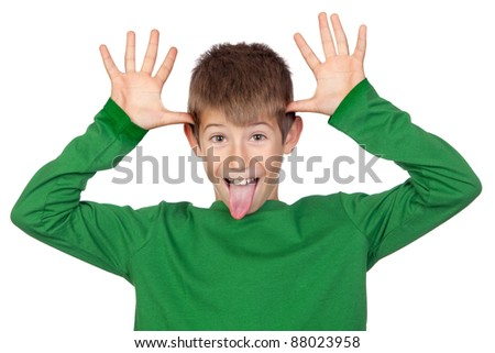 Funny child with green t-shirt mocking isolated on white background - stock photo