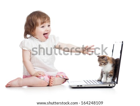 Funny child with laptop and cat baby - stock photo