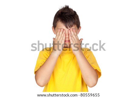 Funny child with yellow t-shirt covering eyes isolated on white background - stock photo