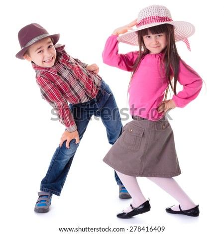 Funny children: boy and girl wearing hats and posing in unusual posture - stock photo