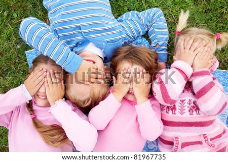 funny children closed their eyes with their hands