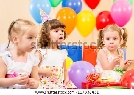 funny children on birthday party - stock photo