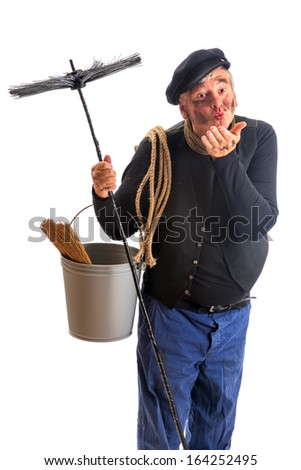 Funny chimney sweep offering a kiss for good fortune - stock photo