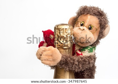 Funny Christmas background, knitted monkey hold champagne bottle, symbol to merry christmas and happy new year, a year of monkeys. - stock photo