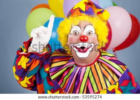 Funny circus clown with a bright idea. - stock photo