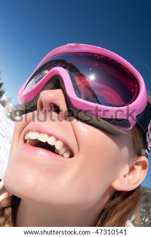 Funny close portrait of a young girl in ski mask - stock photo
