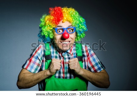 Funny clown against the dark background - stock photo