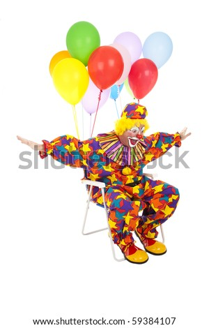 Funny clown flying through the air in his lawn chair with helium balloons attached.  Isolated on white. - stock photo